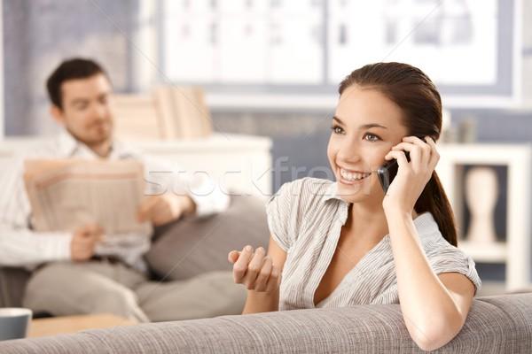魅力のある女性 話し 電話 笑みを浮かべて 小さな 座って ストックフォト © nyul