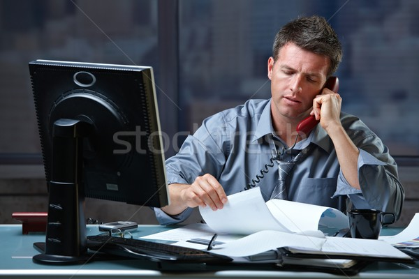 Businessman on call in overtime  Stock photo © nyul