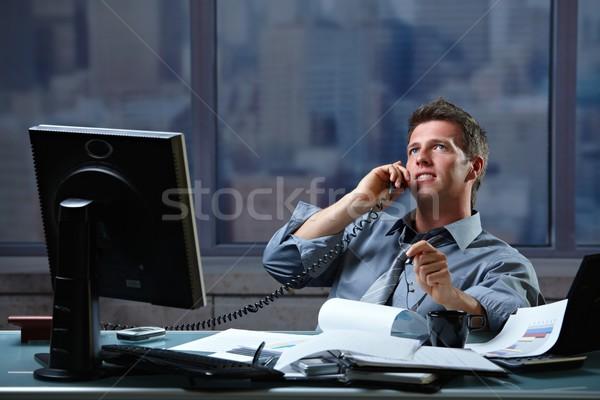 Businessman calling on landline at office Stock photo © nyul