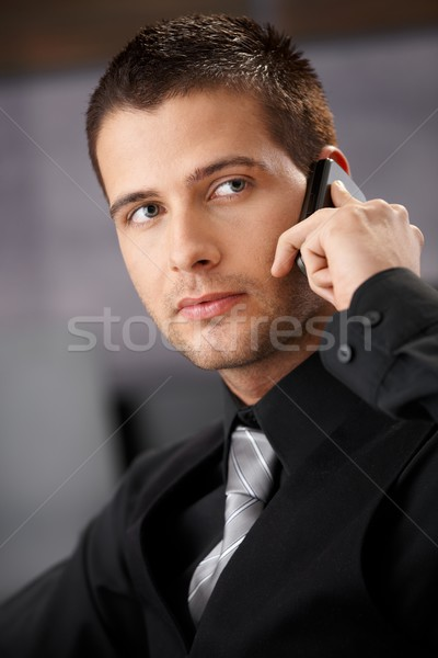 Handsome businessman using mobile Stock photo © nyul