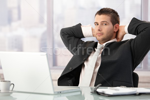 Young businessman relaxing in office Stock photo © nyul
