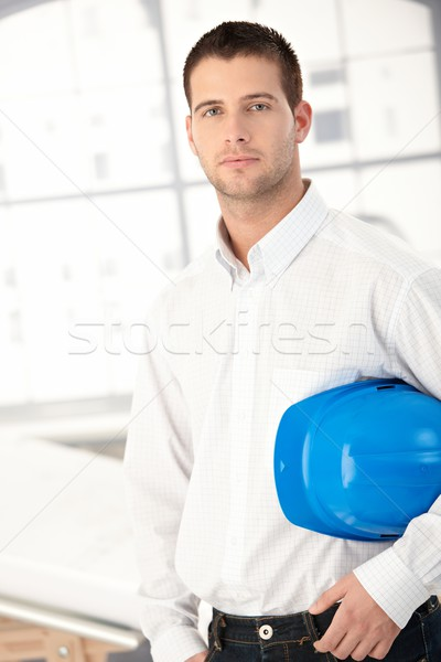 Young engineer standing in bright office Stock photo © nyul