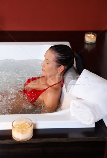 Mulher biquíni mulher bonita relaxante jacuzzi bem-estar Foto stock © nyul