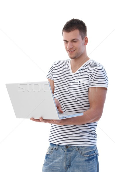 Young man browsing internet smiling Stock photo © nyul