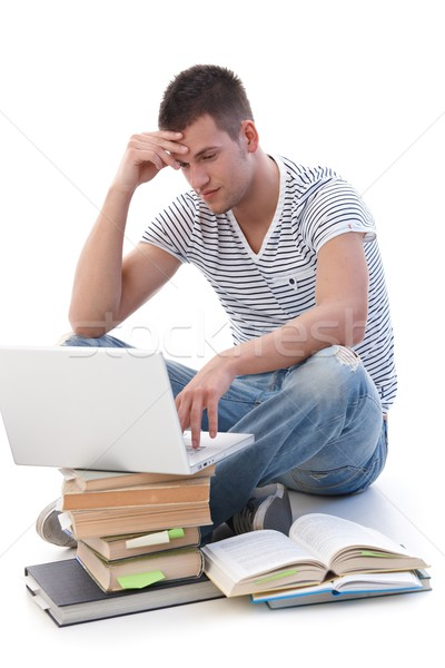 College student doing homework on laptop Stock photo © nyul
