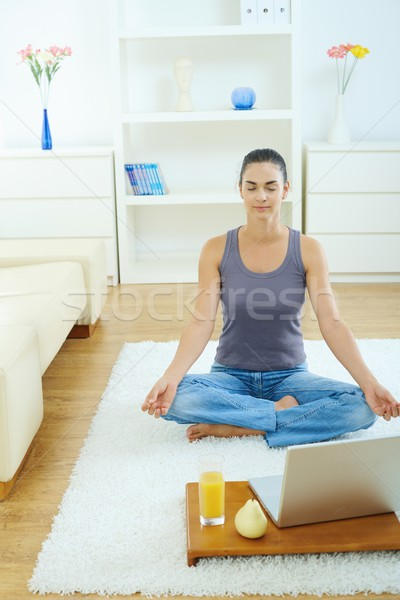 Woman using meditating at home Stock photo © nyul