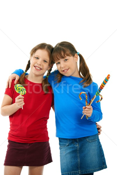 Smiling girls with lollipops Stock photo © nyul