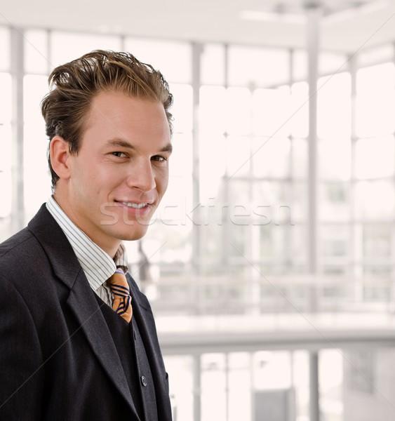 Portré boldog üzletember fiatal mosolyog iroda Stock fotó © nyul