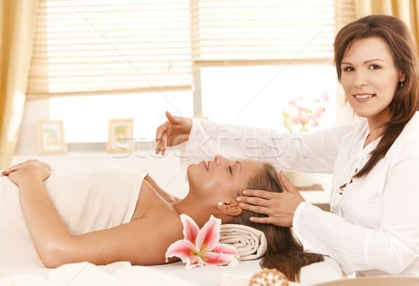 Masseur doing head massage Stock photo © nyul
