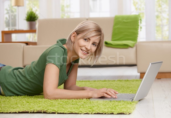 Woman surfing the internet at home Stock photo © nyul