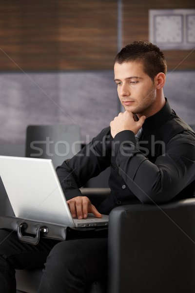 Stock photo: Young businessman with laptop