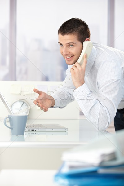 Stock photo: Young businessman on phone smiling