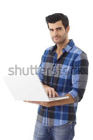 Casual man holding laptop smiling Stock photo © nyul