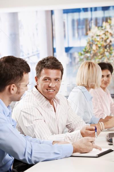 Uomini d'affari parlando incontro di lavoro felice riunione ufficio Foto d'archivio © nyul