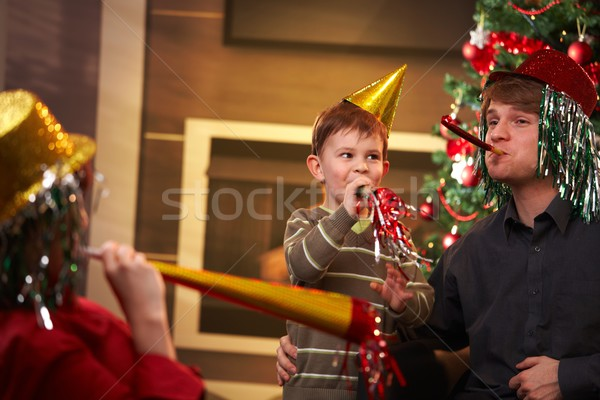 Happy family celebrating new year's eve together Stock photo © nyul