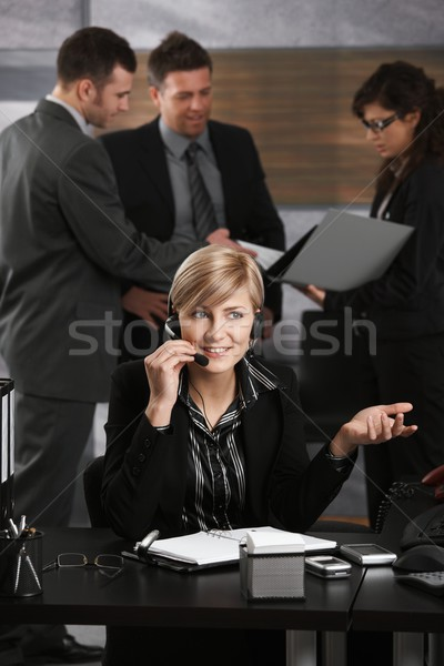 Receptionist receiving calls Stock photo © nyul