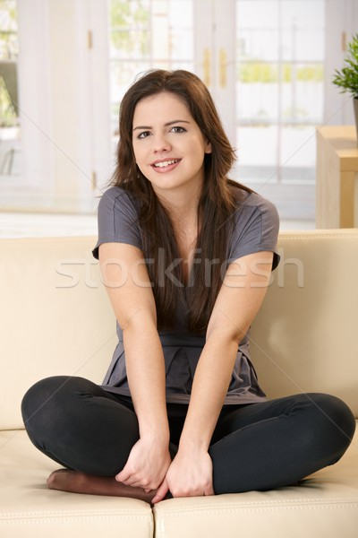 Girl sitting on couch Stock photo © nyul