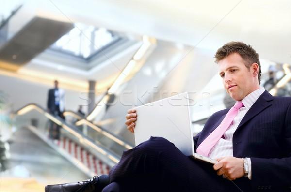бизнесмен лобби сидят используя ноутбук компьютер Сток-фото © nyul