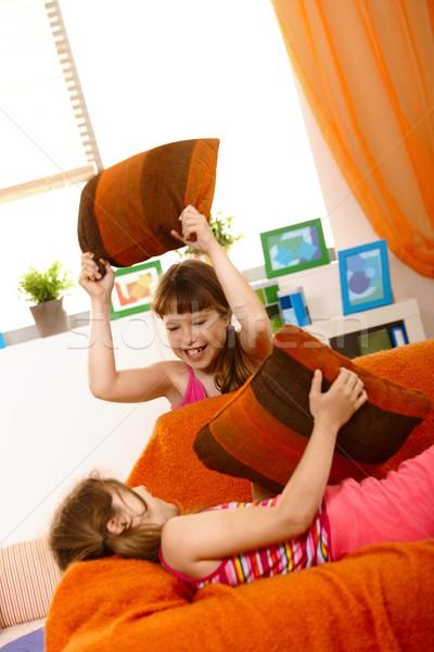 Küçük kızlar yastık kavgası kanepe gülme Stok fotoğraf © nyul