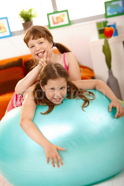 Schoolgirl teasing friend on gym ball Stock photo © nyul