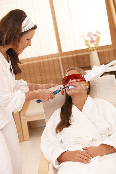Woman getting tooth whitening Stock photo © nyul