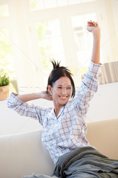 Cheerful girl stretching in morning Stock photo © nyul