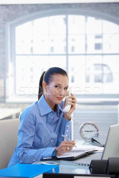 Office girl taking landline call Stock photo © nyul
