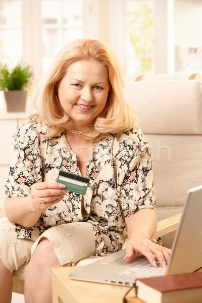 Stock photo: Senior woman shopping online