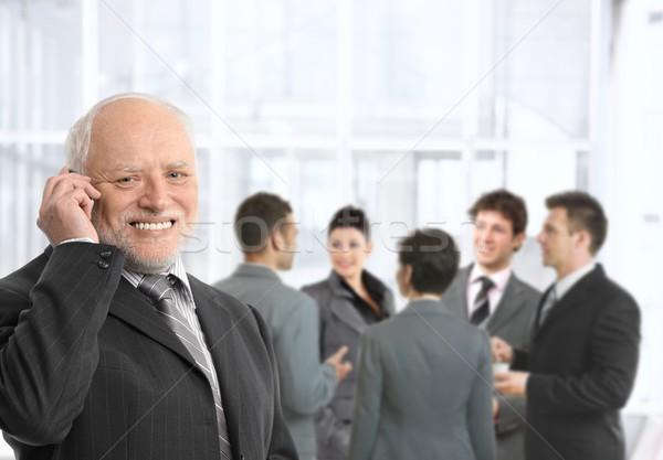 Idős üzletember telefon iroda beszél mobiltelefon Stock fotó © nyul