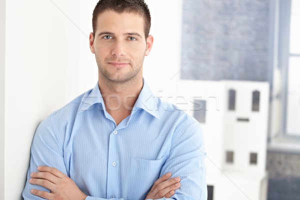 Handsome man smiling arms crossed Stock photo © nyul