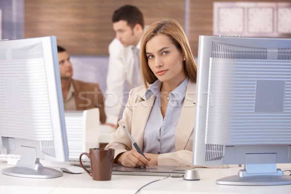 Young woman learning computer graphic design Stock photo © nyul