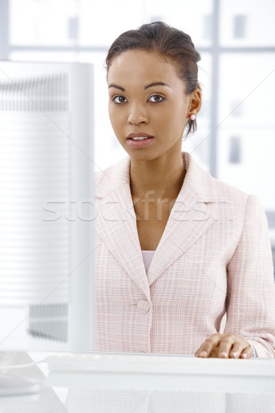 Serious businesswoman at desk Stock photo © nyul