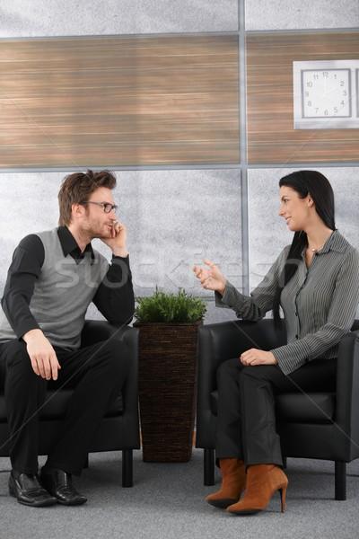 Posiedzenia biuro lobby młodych mówić Zdjęcia stock © nyul