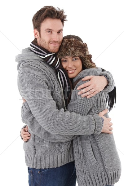 Loving couple cuddling up to each other smiling Stock photo © nyul
