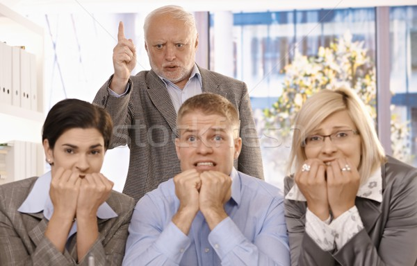 Angry boss shouting at scared employees Stock photo © nyul