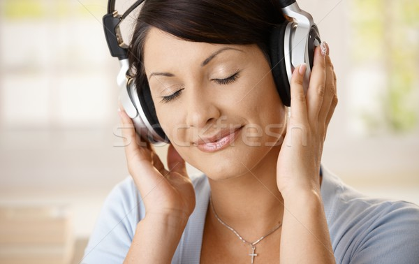 Woman listening music on headphones Stock photo © nyul