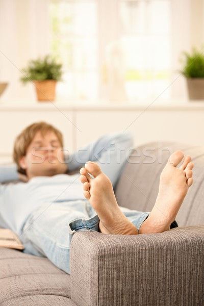 Man relaxing on couch Stock photo © nyul