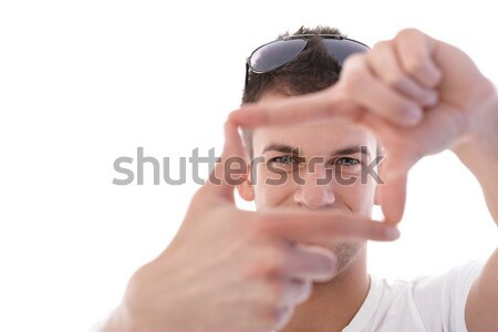 Young man imitating photographing smiling Stock photo © nyul