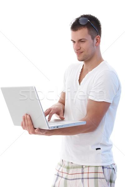 Usando laptop em pé laptop mãos internet Foto stock © nyul
