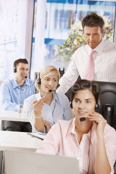 Menedzser ügyfélszolgálat üzlet nő mosoly férfi Stock fotó © nyul