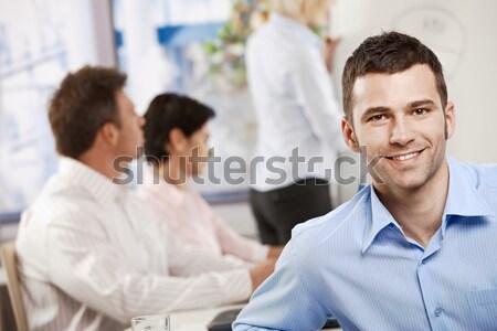 Boldog üzletember iroda portré mosolyog kollégák Stock fotó © nyul