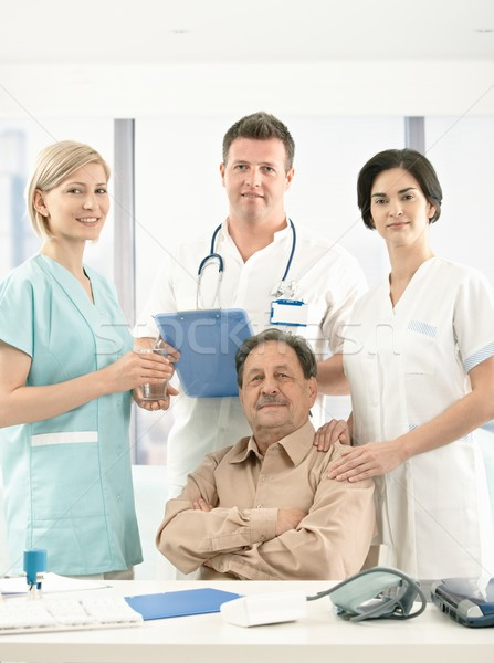Portrait of senior patient and medical crew Stock photo © nyul