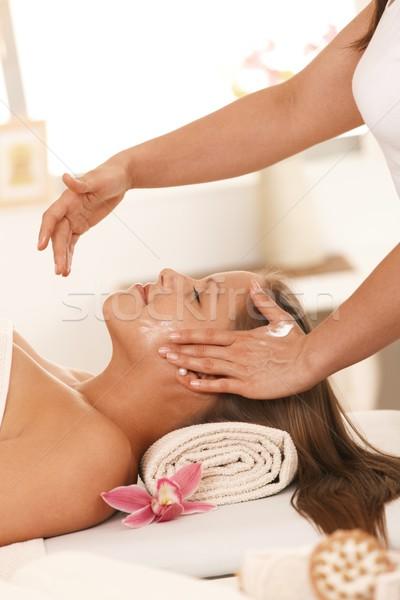 Young woman getting facial massage Stock photo © nyul