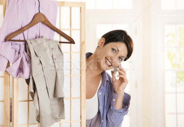 Woman dressing up and talking on mobile Stock photo © nyul