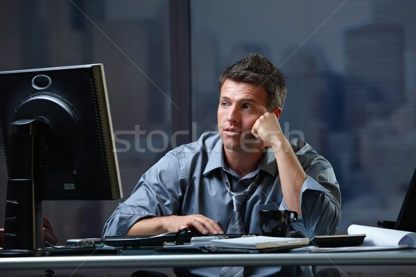 Tired professional looking at screen troubled Stock photo © nyul