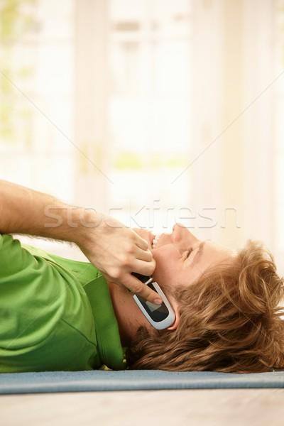 Happy guy talking on phone Stock photo © nyul