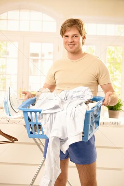 Sonriendo tipo cesta de la ropa retrato jóvenes Foto stock © nyul