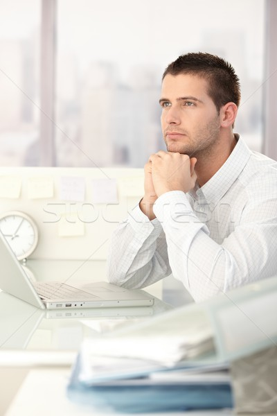 Daydreaming businessman sitting at desk Stock photo © nyul
