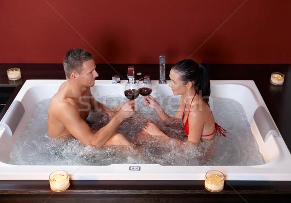 Couple celebrating in jacuzzi Stock photo © nyul