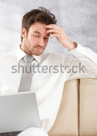 Athletic man browsing internet on laptop Stock photo © nyul